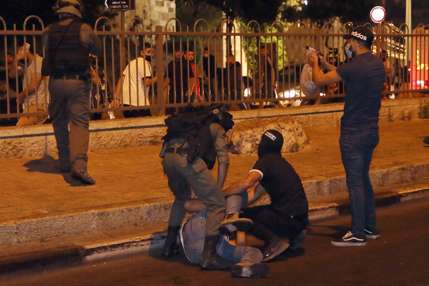 Israeli security forces arrest a Palestinian man near the Damascus Gate to the Old City of Jerusalem. Photo / AP