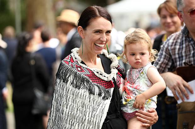 New Zealand Prime Minister Jacinda Ardern and her daughter Neve Gayford at the upper Treaty grounds at Waitangi on Tuesday. Photo / Getty Images