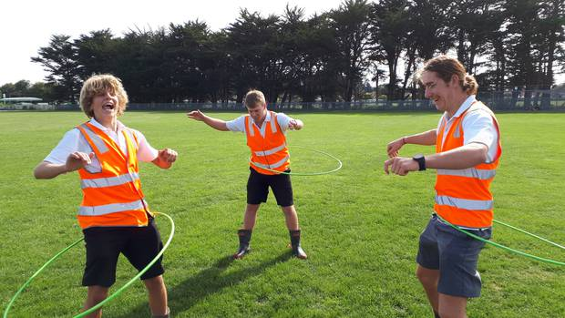Whanganui High School prefects Cameron Russell, Thomas Friedel and Jack Clifton (all 17) have a bit of fun with the hula hoops in-between obstacle course races. Photo / Jesse King