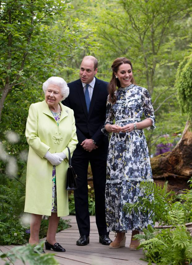Britain's Queen Elizabeth II visits the 'Back to Nature' garden with Prince William and Kate, Duchess of Cambridge at the RHS Chelsea Flower Show at the Royal Hospital Chelsea in London. Photo / AP