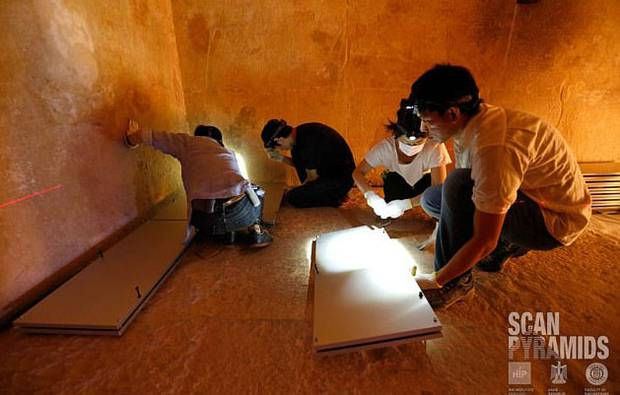 Experts from the Operation ScanPyramids team investigate the inside of the ancient structure. Photo / Operation ScanPyramids
