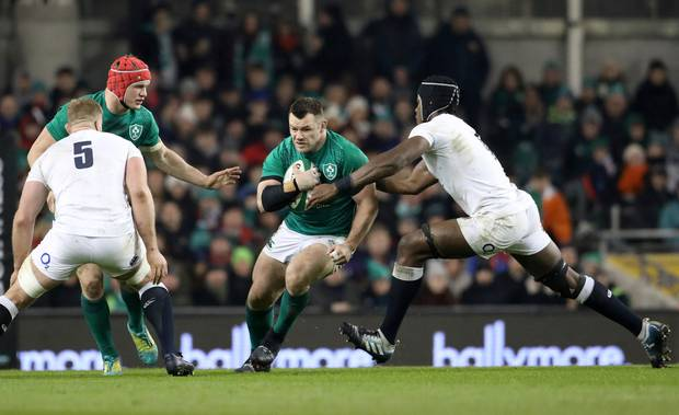 Ireland's Cian Healy runs at England's Maro Itoje, right, during the Six Nations rugby union international between Ireland and England, in Dublin, Ireland. Photo / AP