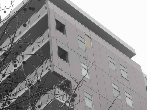 The cladding appears to have fallen from an upper storey of the building on the corner of Victoria St West. Photo / Will Trafford