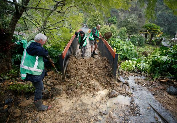 Volunteers (from left) Mike Morresey, Kayla Franks and Stuart Peterson get stuck in. Photo / Michael Cunningham