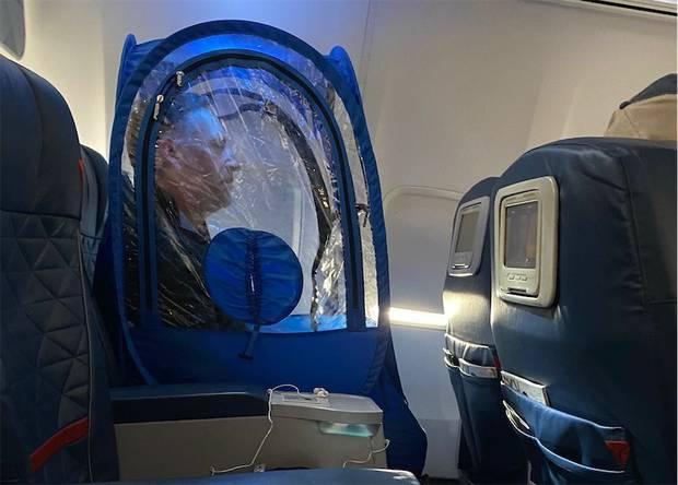 Passenger Wears Plastic Tent On Plane To Avoid Coronavirus Nz Herald