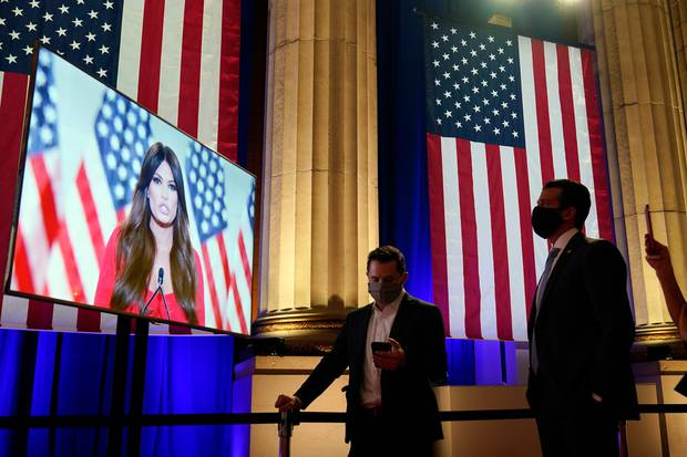 Donald Trump Jr., right, watches as his girlfriend Kimberly Guilfoyle speaks. Photo / AP