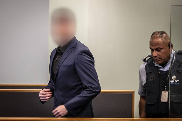 The accused entering the dock in the High Court. Photo / NZ Herald