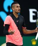 Nick Kyrgios complains about a helicopter flying overhead during his Australian Open clash against Viktor Troicki yesterday. Photo / Getty Images.