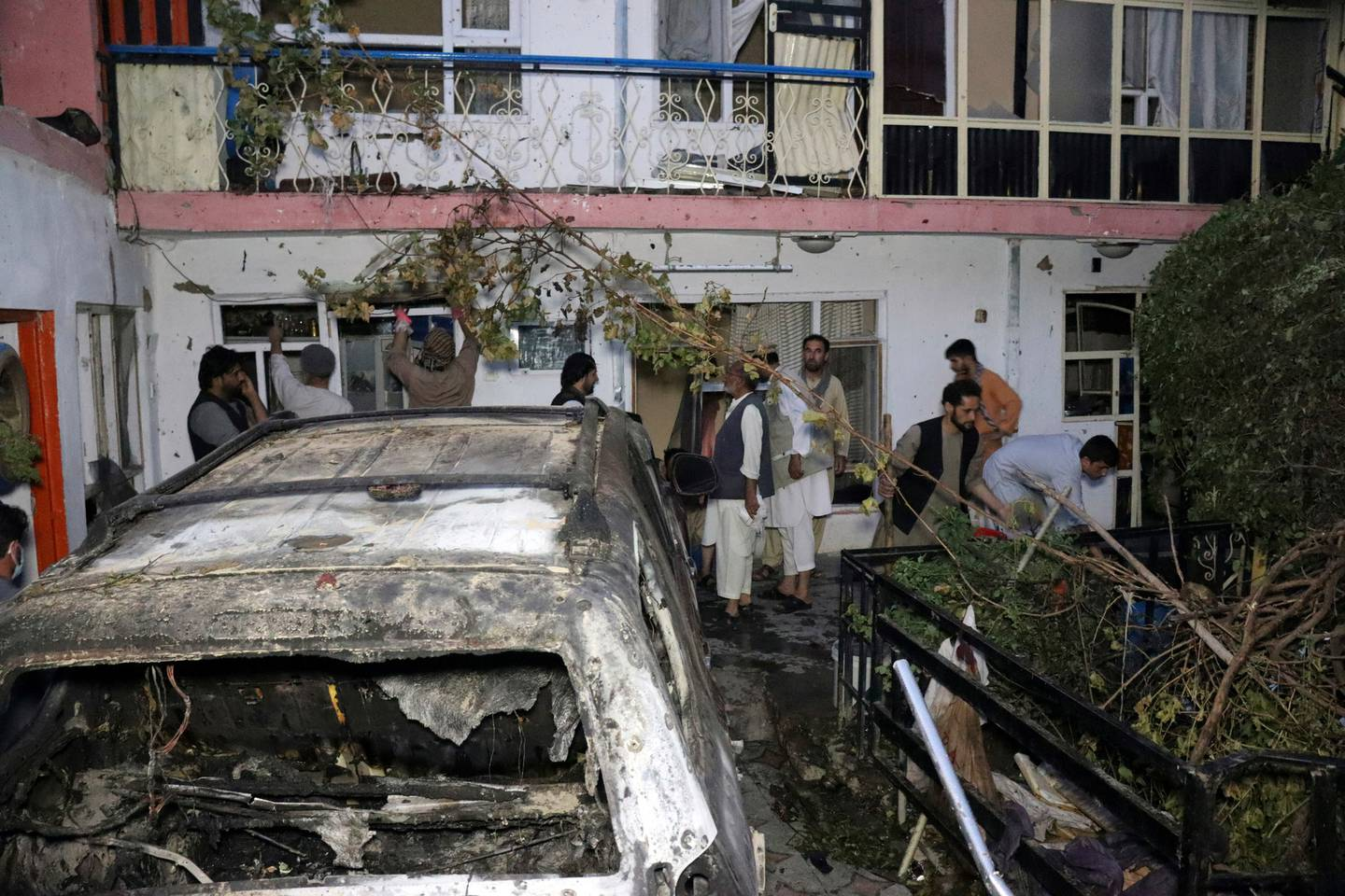 Afghan people are seen inside a house after U.S. drone strike in Kabul, Afghanistan. Photo / AP
