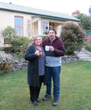 Linda and Casper Barnard raise a mug to their new house in Mornington, Dunedin. Photo / Joshua Riddiford