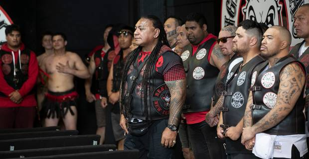 President of the Waikato Mongrel Mob Kingdom Chapter Sonny Fatupaito keeps an eye on things as guests are welcomed into the gangs headquaters for a hui in Hamilton. Photo / Alan Gibson