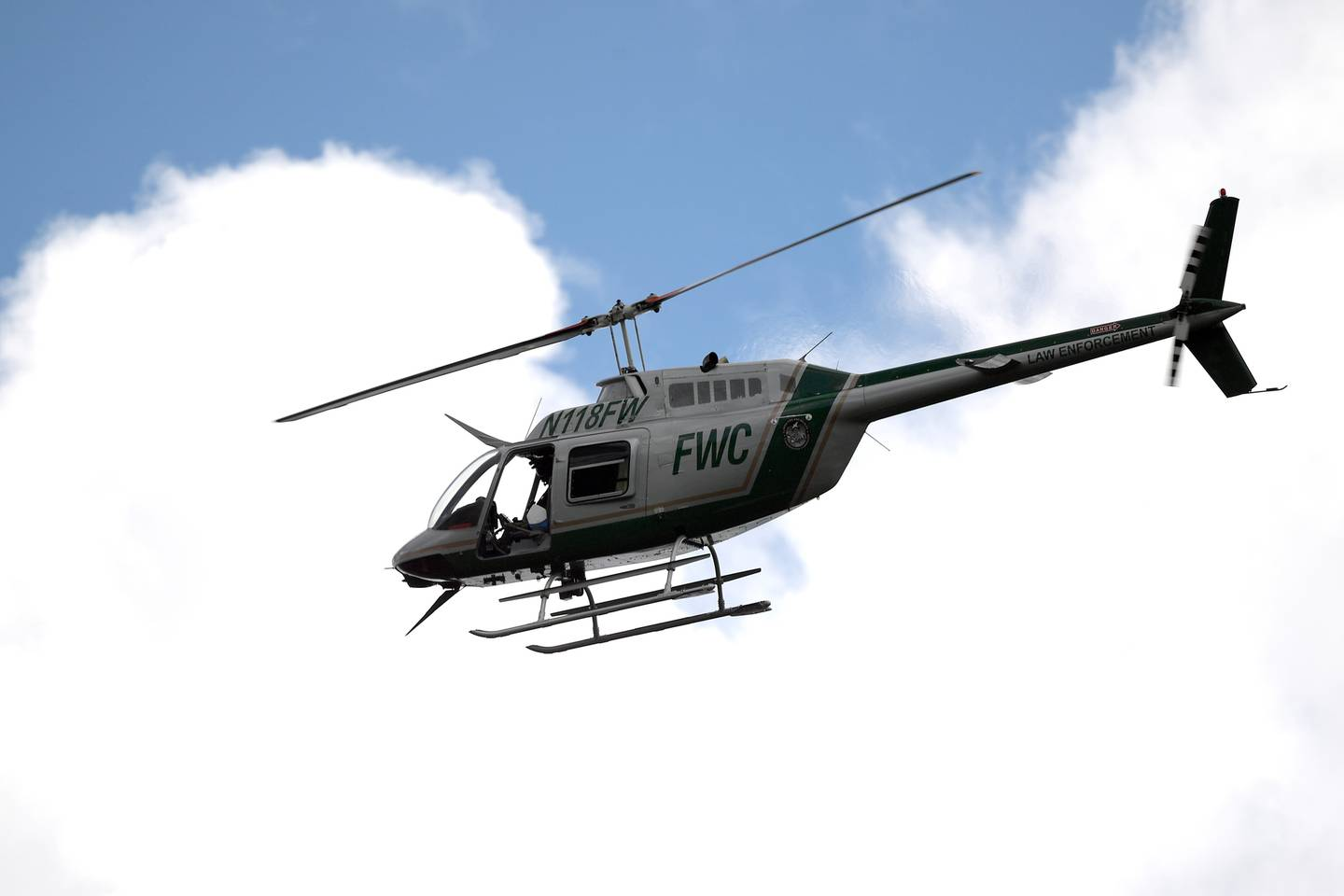 A Florida Fish and Wildlife Conservation Commission helicopter flies overhead during a search for Brian Laundrie in the Carlton Reserve. Photo / AP