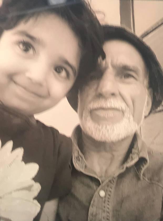 Haji Daoud Nabi, 71, and his grandchild