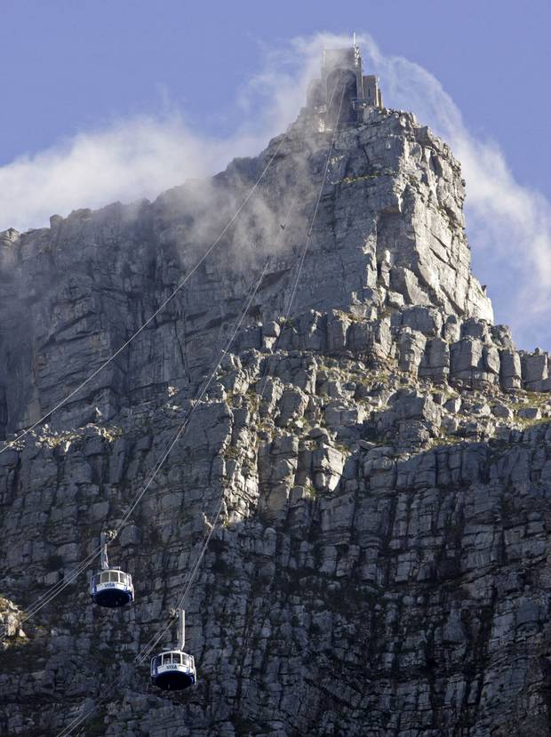 Emergency responders descended on ropes from a cable car to recover the bodies of two male climbers, including a Japanese citizen, who died after falling from a cliff. Photo / AP