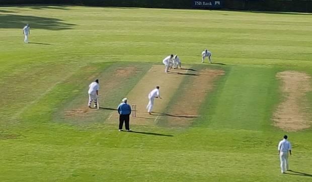 Wanganui's Chris Sharrock bowling to Taranaki's top scorer Josh Borrell on a picturesque Saturday at Pukekura Park.