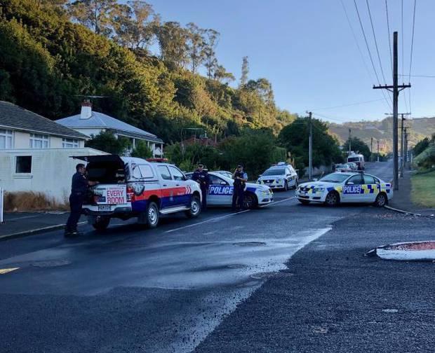 Police outside an address in Somerville St, Dunedin. Photo / ODT