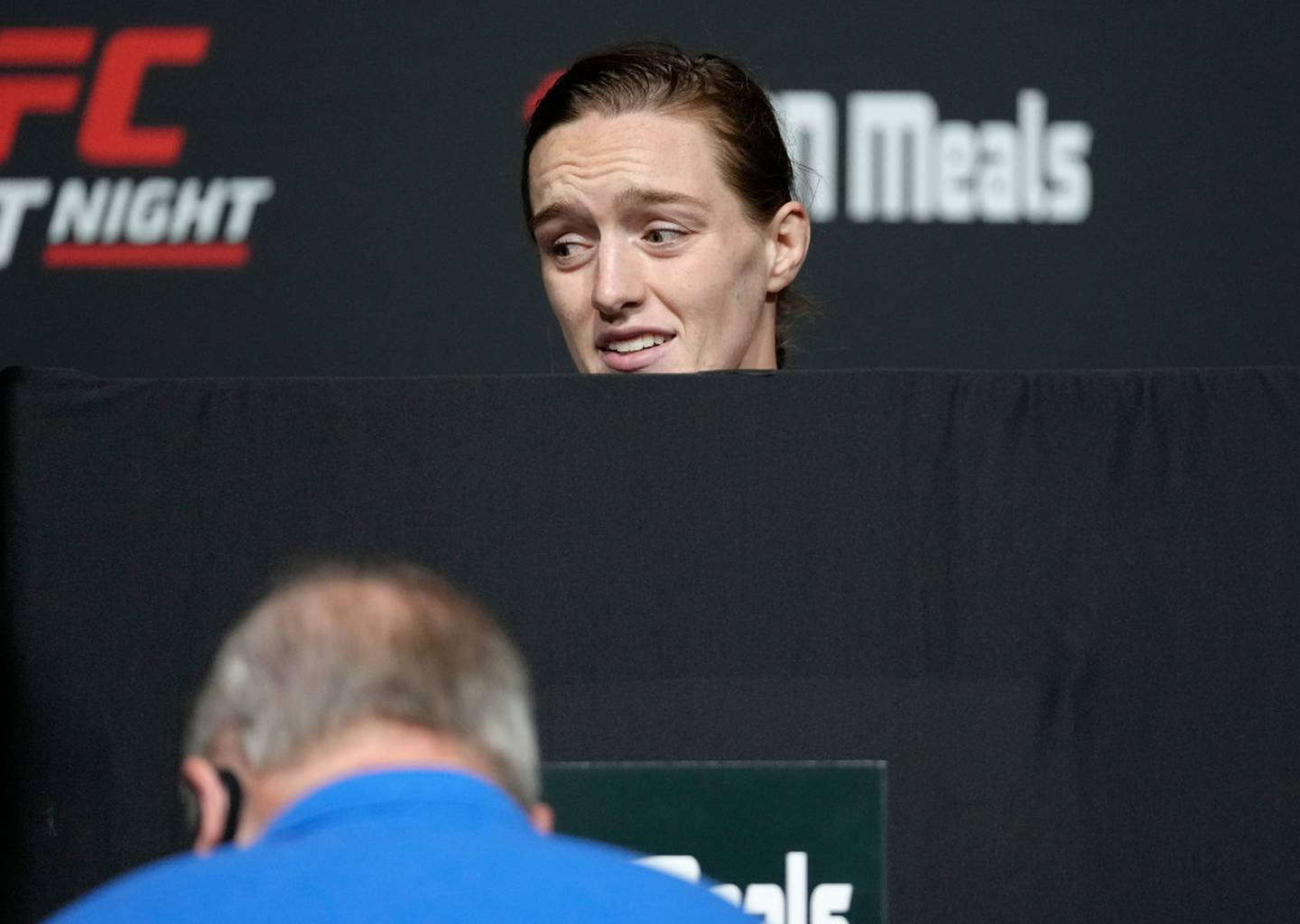 Aspen Ladd looks visibly upset as she attempts to make weight. Photo / Getty