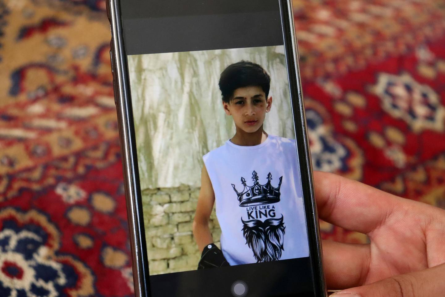 Emal Ahmadi shows a photo of his young family member who was killed during a U.S. drone strike on their home in Kabul. Photo / AP