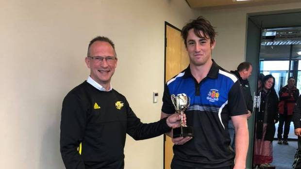 Jason Myers receives the Under 20's MVP Cup from Hurricanes Youth Rugby Council chairman Gordon Noble-Campbell in Palmerston North on Sunday.