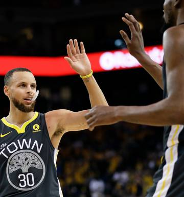4d9b1e3500ac ... Golden State Warriors guard Stephen Curry (30) celebrates with forward  Kevin Durant during the