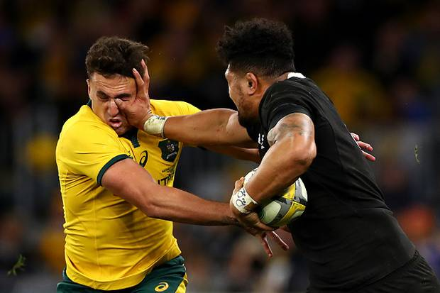 Ardie Savea fends off Tom Banks of the Wallabies. Photo / Getty
