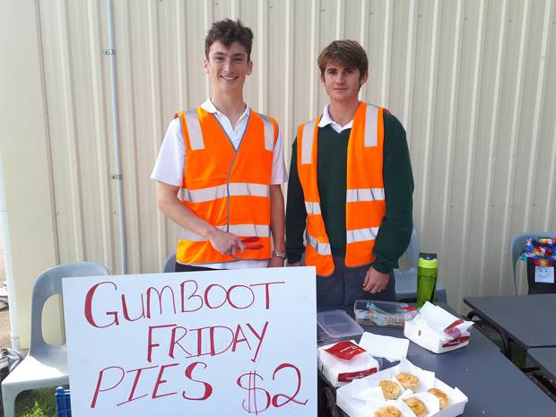 Alex Nevil, 16 and Patrick Madder, 17 looked after the pies and collected the money for the Gumboot Friday fund. Photo / Jesse King