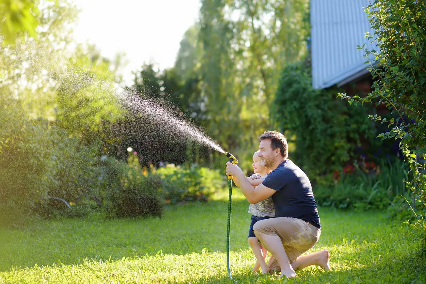 At present Aucklanders can use a hose with a nozzle to water the garden but not sprinklers. Photo / File
