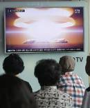 People watch a TV news program reporting North Korea's nuclear test at Seoul Railway Station in Seoul, South Korea. Photo / AP