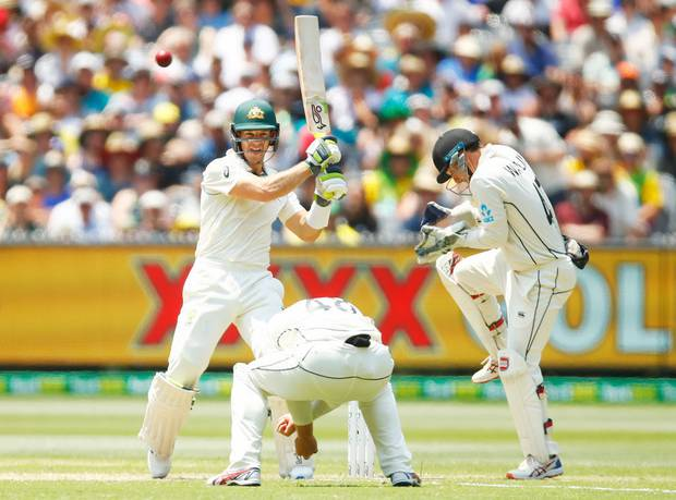 Tim Paine hits out against the Black Caps. Photo / Getty