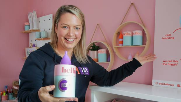Hello Cup co-founder Robyn McLean offering an alternative to tampons for New York Marathon runners. Photo / Warren Buckland