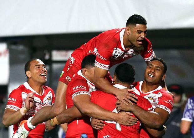 Tonga players celebrate the try of Solomone Kata. Photosport
