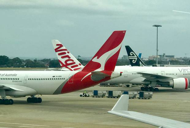 Airlines say charges and fees make up 53 per cent of an Economy fare across the Tasman. Photo / Grant Bradley