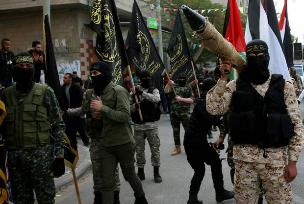 Palestinian Al-Quds Brigades, the military wing of the Islamic Jihad group, march with their rifles during a protest against President Trump. Photo / AP