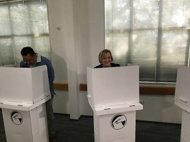 Judith Collins and husband David Wong-Tung casting their votes. Photo / Michael Neilson