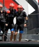 Emirates Team New Zealand crew embrace after defeating Oracle Team USA. Photo / AP