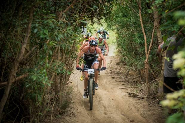 Rotorua's Sam Osborne leads a pack of bikers during Xterra Taiwan. Photo / Supplied