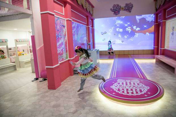 Girls dressed like anime characters play inside PriPara Kids Cafe in Yongin. Photo / Jean Chung, Washington Post