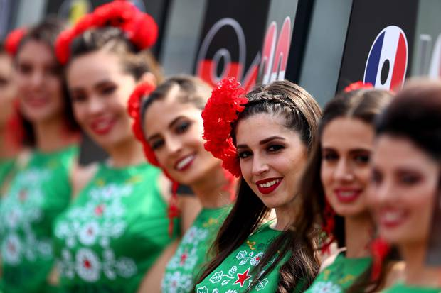 Grid girls look on before the Formula One Grand Prix of Mexico. Photo / Getty