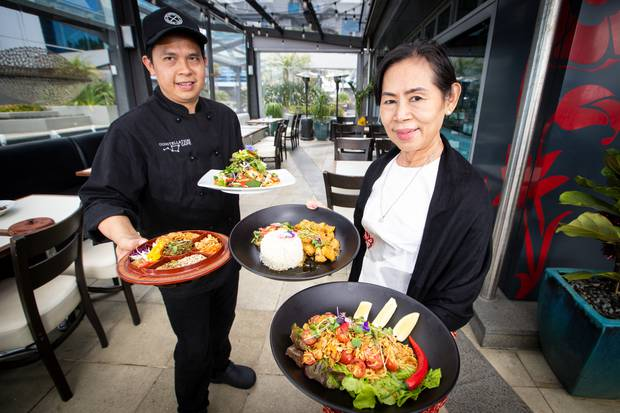 Chef David Vuong Pham, left, and Chef May Hla Hla Yee present their Burmese cuisine at the Constellation Cafe in Rosedale. Photo / Jason Oxenham