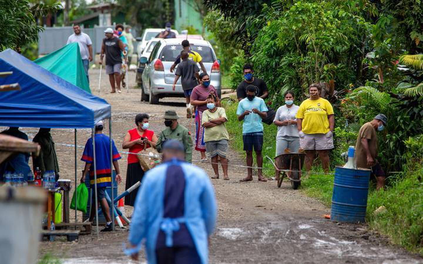 Villagers are questioned about their movements by Fijian military. Photo / Fijian Government via Facebook, File