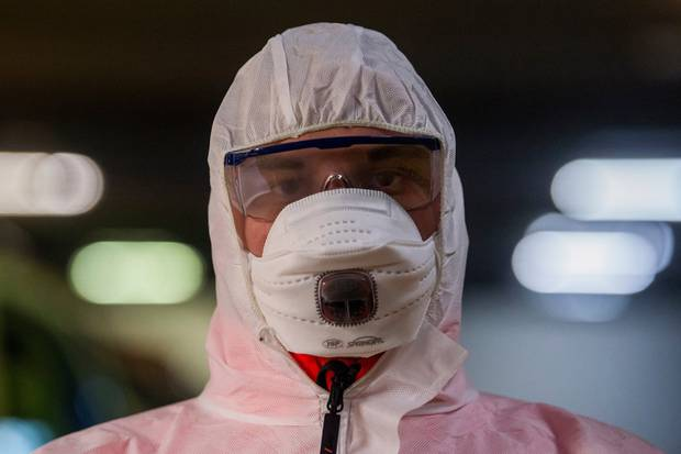 A paramedic on call wears on protective gear as a precaution against the spread of the novel coronavirus in Budapest, Hungary. Photo / AP