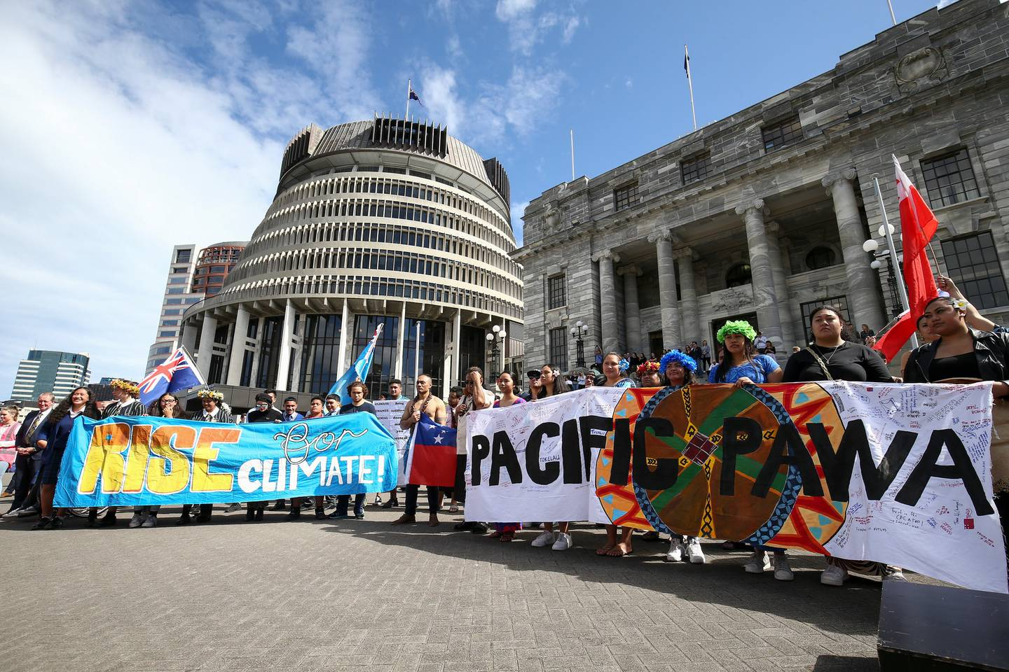 Protestors hold banners at Parliament during a strike to raise climate change awareness. Photo / Mark Mitchell