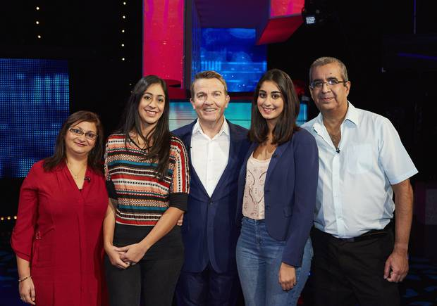 The Ghandi family with host Bradley Walsh (centre) on the set of The Family Chase. Photo / ITV/REX/Shutterstock