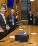Prime Minister Bill English receiving a standing ovation from his caucus after arriving for their meeting at Parliament. Photo / Mark Mitchell