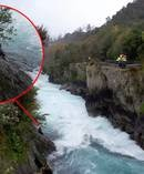 The female kayaker is stranded on a rock at Huka Falls. Photo / Rosie Cronin