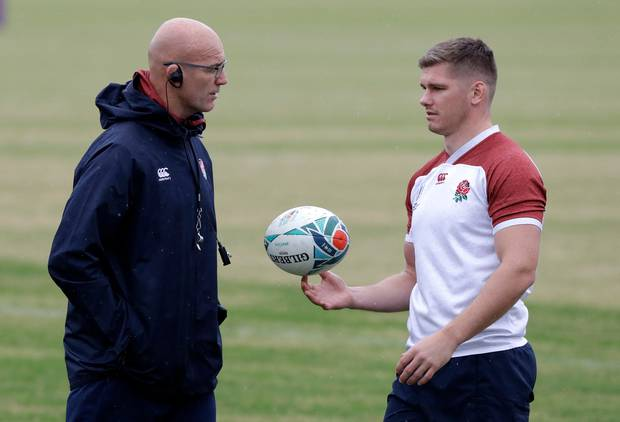 England's Owen Farrell, right, talks with defence coach John Mitchell during a training session in Tokyo, Japan: Photo / AP