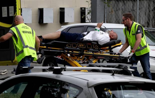 Khaled Al-Jammali being stretchered into hospital. Photo / AP