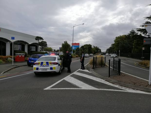 Armed police on Langdons Road in Papanui. Photo / Broadcast Media