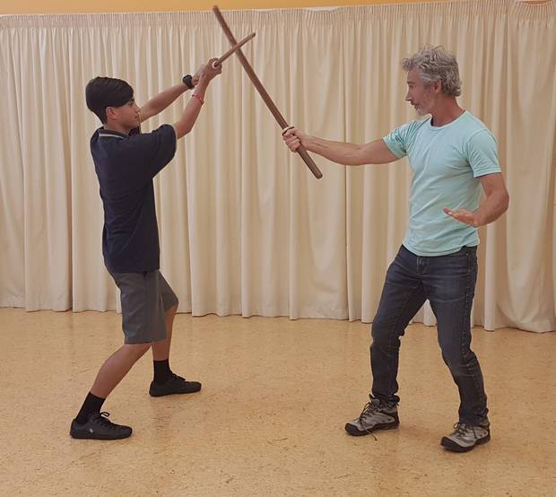 Trent Thompson-Tawhara learning sword fighting stunt skills from actor Jed Brophy. Photo / Anna Groves