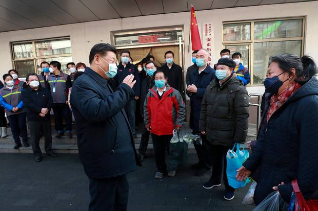 Chinese President Xi Jinping speaks to residents as he inspects the novel coronavirus pneumonia prevention and control work at a neighbourhood in Beijing. Photo / AP